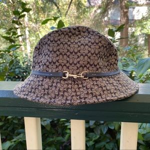 Coach bucket hat with leather strap detail